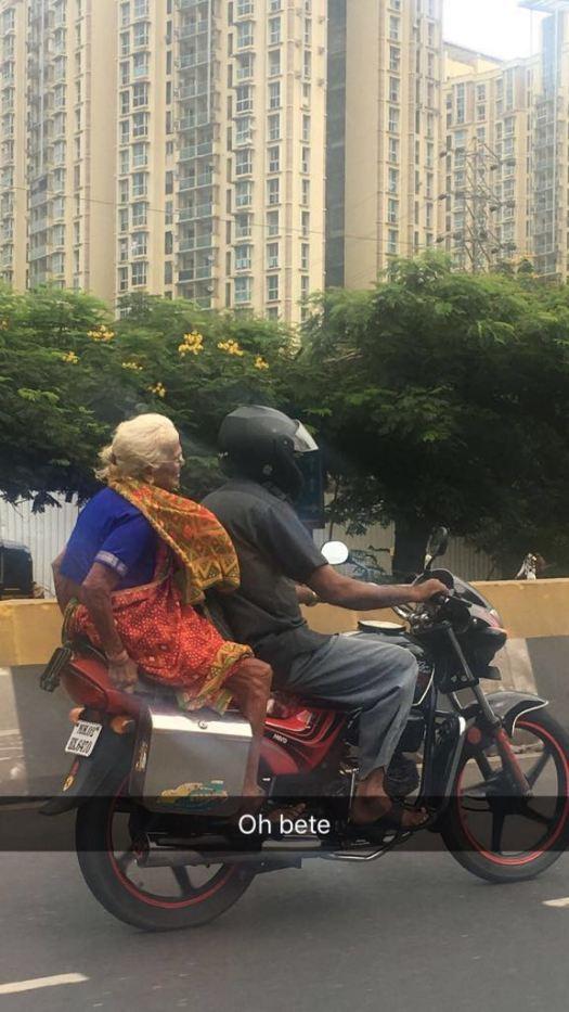 an old lady on bike
